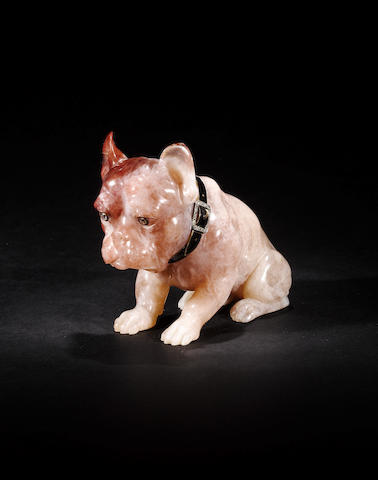 A pink quartz model of a dog with diamond set eyes