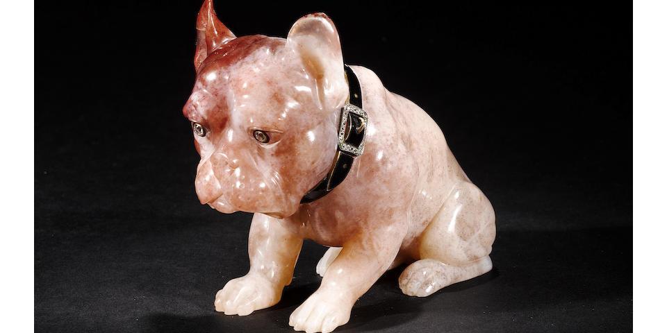 A pink quartz model of a dog with diamond set eyes