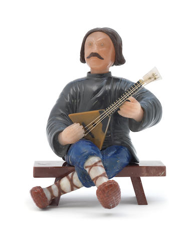 A hardstone model of a balalaika player unmarked