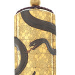 A gold four-case inro with snake