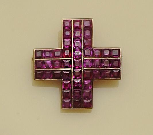 A ruby cross brooch