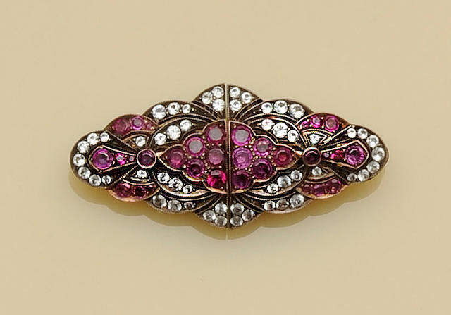 A ruby and white sapphire double clip brooch