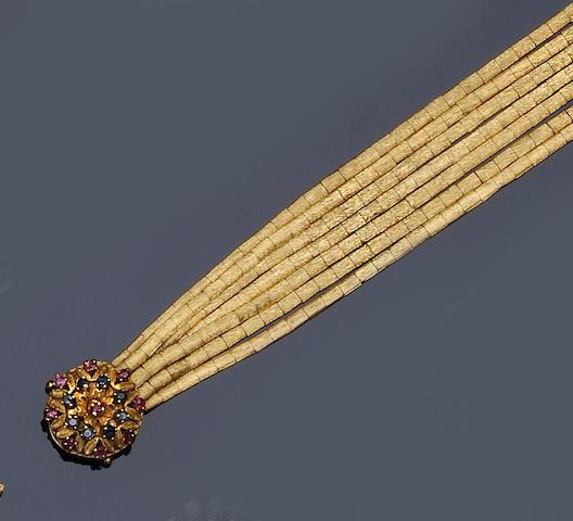A ruby and sapphire set multi-strand bracelet