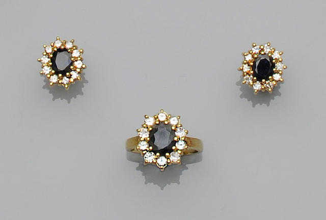 A sapphire and diamond cluster ring and a pair of earstuds ensuite (2)