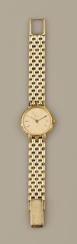 Asprey: A lady's 14ct gold wristwatch