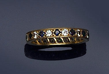 A sapphire and diamond full hoop eternity ring