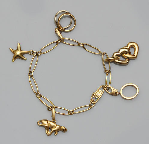 Tiffany: A charm bracelet by Elsa Peretti, with Cartier charms