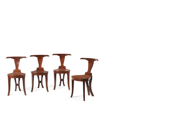 A set of four late George III mahogany hall chairs
