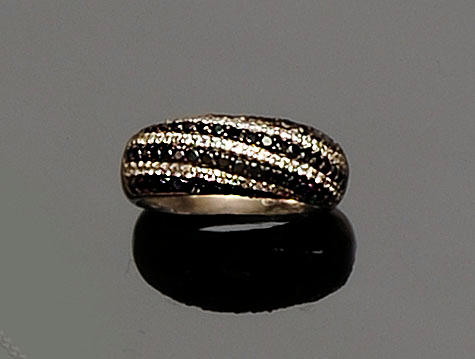 A diamond and black stone ring
