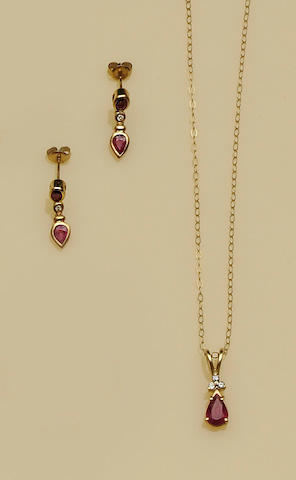 A ruby and diamond pendant and a pair of ruby and diamond earpendants (2)