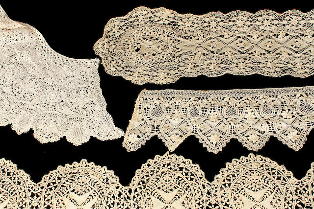 A collection of cream Maltese lace collars, scarves and flouncing