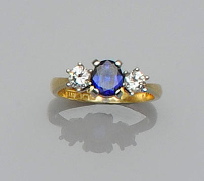 An 18ct gold sapphire and diamond three stone ring