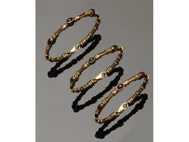 A suite of three vari-gem set bangles (3)
