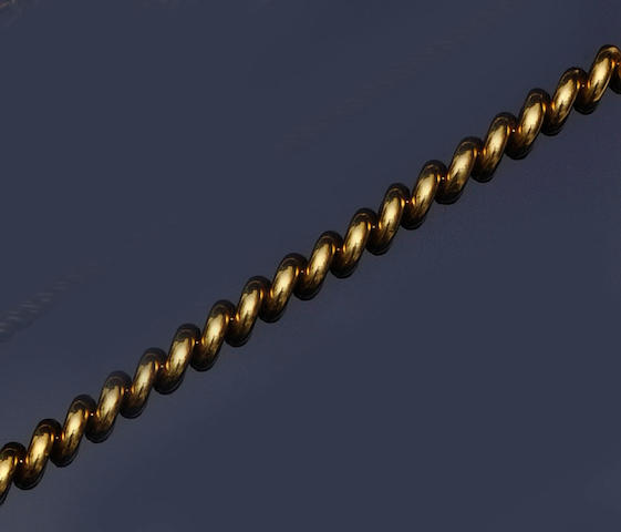 A yellow precious metal necklace