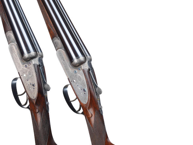 A pair of 12-bore sidelock ejector guns by F. Beesley, no. 2580/1 In a Churchill, Atkin, Grant & Lang brass-mounted oak and leather case