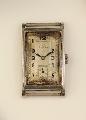 Omega: A gentleman's stainless steel watch head, circa 1930