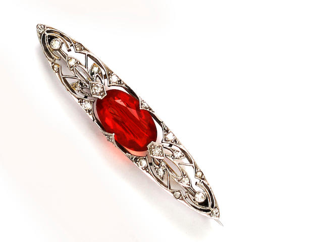 An Edwardian fire opal and diamond brooch
