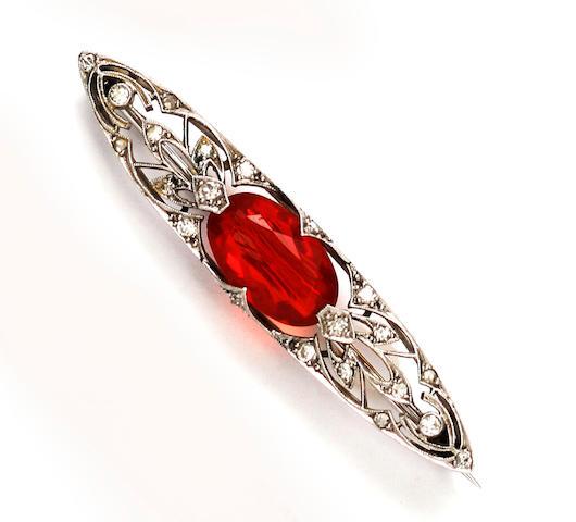 An Edwardian fire opal and diamond brooch