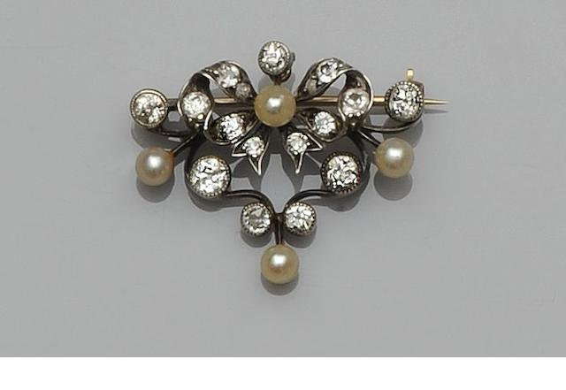 A late Victorian diamond and cultured pearl set ribbon scroll brooch