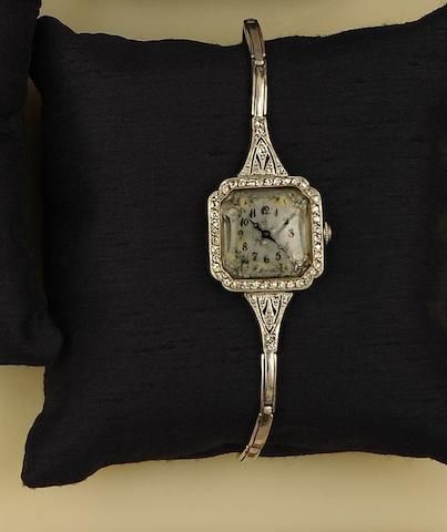 An Edwardian diamond cocktail watch