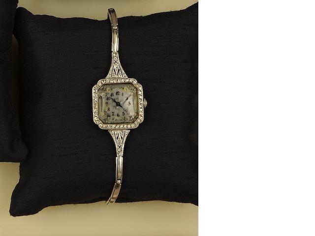 An Edwardian diamond cocktail watch