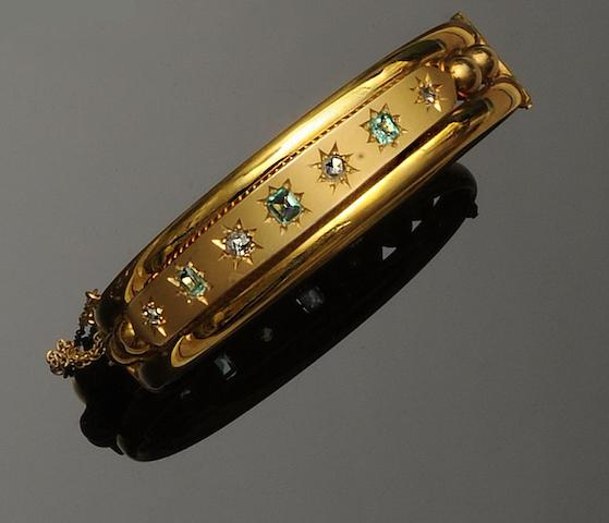A Victorian emerald and diamond set bangle (4)