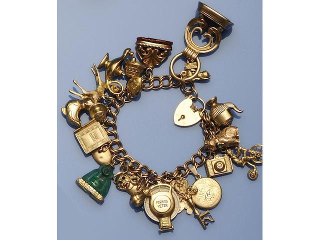 A 9ct gold charm bracelet (7)