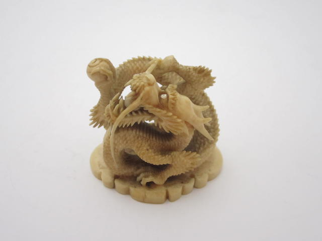 A carved ivory dragon   19th century