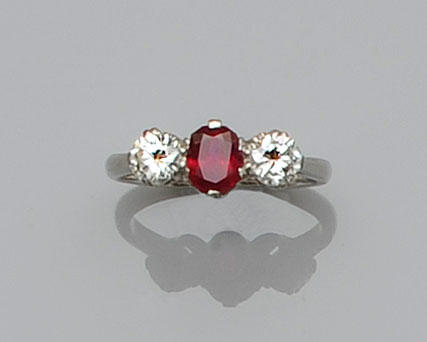 A ruby and diamond three stone ring
