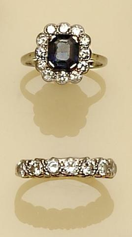 A diamond and sapphire cluster ring and a seven stone diamond ring (2)