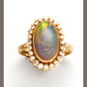 An 18ct gold mounted opal and diamond cluster ring