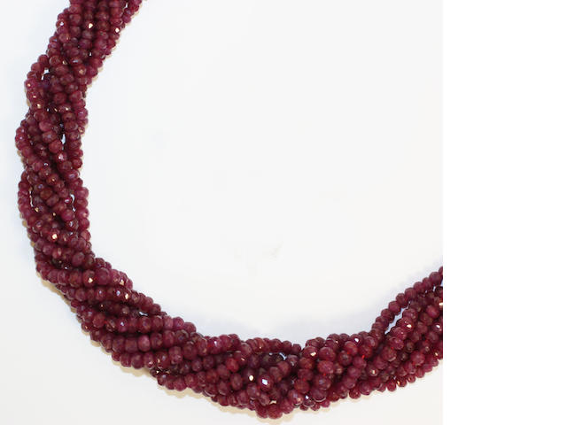A multi-strand ruby bead necklace