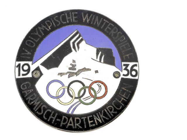 Commemorative Car Plaque Of circular for, bearing the official logo of the Winter Olypmnics at Garmisch-Partenkirchen, [1936]