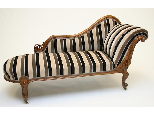 A Victorian walnut framed chaise longue