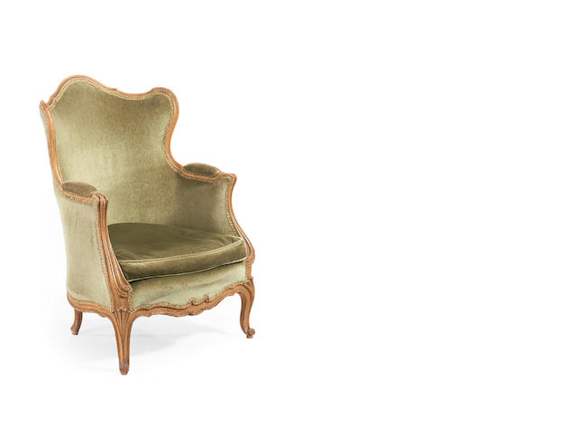 A French late 19th/early 20th century painted wingback bergere in the Louis XV Style