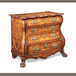 A Dutch third quarter 18th century walnut and fruitwood marquetry bombé serpentine commode