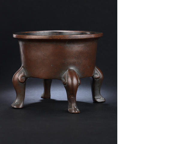 A bronze circular incense burner