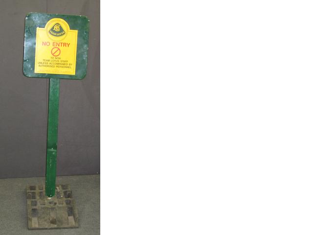 A Team Lotus 'No Entry' sign,