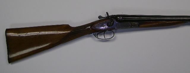 A 12-bore (2¾in) hammer gun by S. Marco, no. 9976 In a leather case