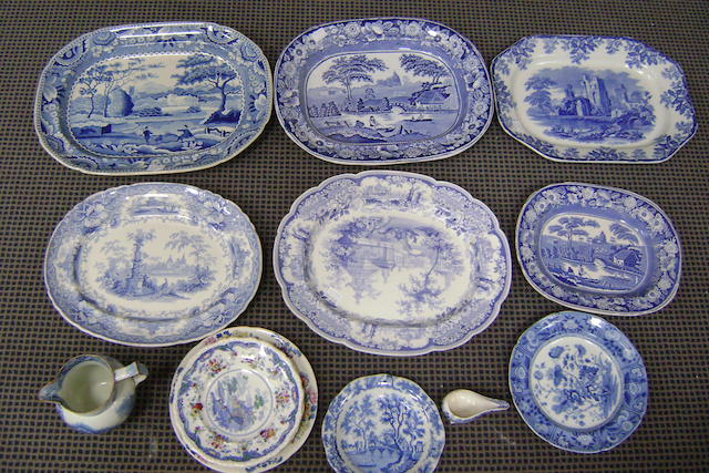 A collection of thirteen blue and white transfer printed wares comprising six serving platters, a water jug, a pap boat and five plates (13)