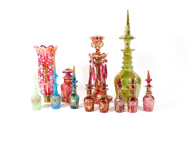 A Bohemian gilt-flashed green glass decanter and stopper, a ruby jar and stopper, a table lustre and eight small scent bottles and stoppers,
