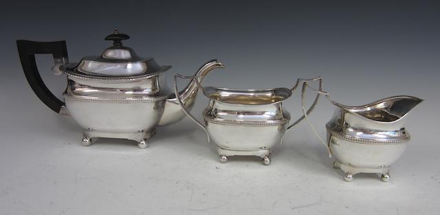 A silver composite three piece tea service  Chester 1911, Birmingham 1923,  (3)