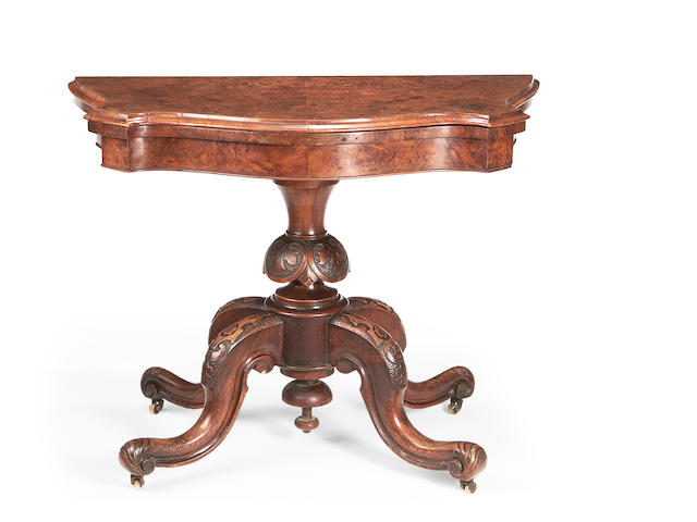 A mid Victorian figured walnut serpentine card table