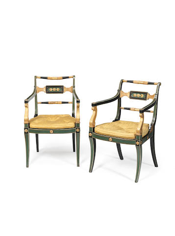 A pair of Regency later green and black decorated an parcel gilt open armchairs