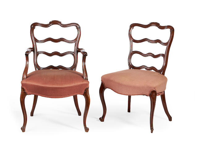 A set of seven Victorian mahogany ladder back dinning chairs in the George III style