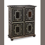 An Italian 19th century ebony and ivory inlaid tall side cabinet in the 17th century style