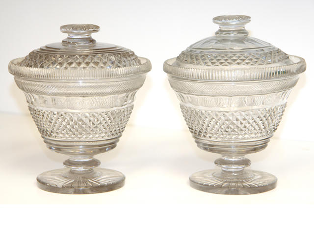 A pair of Irish cut-glass preserve jars or butter-coolers and covers, circa 1825