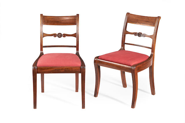 A harlequin set of eleven Regency mahogany dining chairs