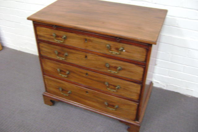 A small George III style Mahogany chest of drawers with brushing slide above four long graduated drawers, 80cm wide