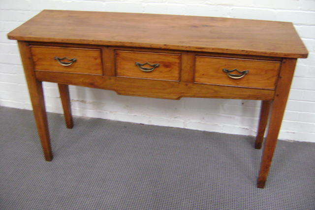 A French cherrywood dresser base, fitted with three drawers, on tapered square legs, 137cm wide